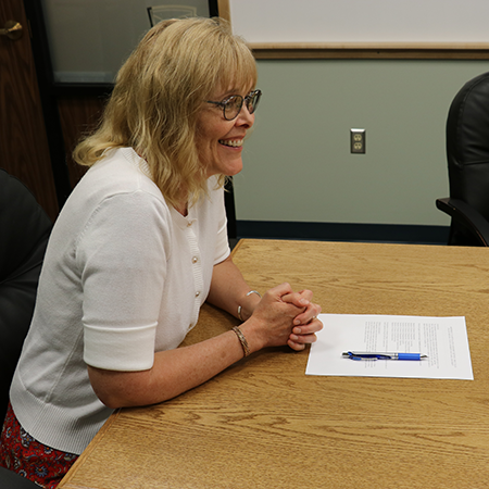 Dr. Heidi Pasek signing the agreement